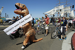 April 14, 2018 - San Diego, CA, USA - While wearing a T-rex costume, Alex Reiss, a UCSD lab manager, takes to the streets during the March for Science in San Diego on Saturday, April 14, 2018. (Credit Image: © Hayne Palmour Iv/TNS via ZUMA Wire)