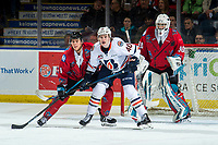 KELOWNA, CANADA - MARCH 9:  Jeff Faith #40 of the Kamloops Blazers looks for the pass while being checked by Devin Steffler #4 in front of the net of Roman Basran #30 of the Kelowna Rockets on March 9, 2019 at Prospera Place in Kelowna, British Columbia, Canada.  (Photo by Marissa Baecker/Shoot the Breeze)