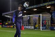 AFC Wimbledon goalkeeper Joe Day (21) warming up prior to kick off during the EFL Sky Bet League 1 match between AFC Wimbledon and Ipswich Town at the Cherry Red Records Stadium, Kingston, England on 11 February 2020.