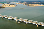Nederland, Zuid-Holland, Hollandsch Diep, 01-04-2016; Moerdijkbruggen over Hollandsch Diep. Intercity op spoorbrug, binnenvaartschip passeert de spoorbruggen.<br /> Railwaybridges across Hollandsch Diep.<br /> luchtfoto (toeslag op standard tarieven);<br /> aerial photo (additional fee required);<br /> copyright foto/photo Siebe Swart