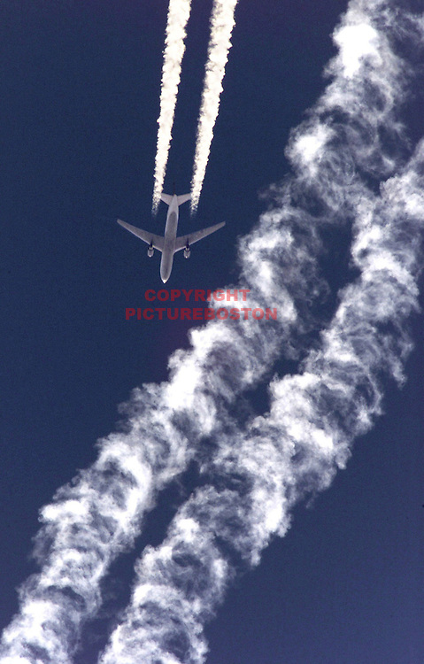 """Various airliners flying in and around Boston's Logan International Airport. Very long lens. NO trickery or photoshop. All photos are """"real time"""" with n with no trickery and NO multiple exposure."""