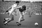 The All Ireland Senior Football Final.1982.19.09.1982.09.19.1982.19th September 1982..The senior final was contested between Offaly and Kerry. Offaly won the title by the narrowest of margins 1.15 to 17 points..A midfield battle for the ball.