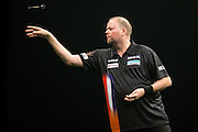 Raymond van Barneveld in action during the Premier League Darts  at the Motorpoint Arena, Cardiff, Wales on 31 March 2016. Photo by Shane Healey.