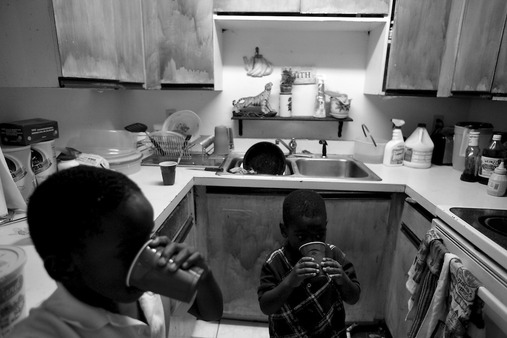 "Brothers Eric Porter, 3, right, and Keylijah Williams, 5, center, get a drink after dinner in the home they share with their great-grandfather Joe Williams. The boys and their other brother have lived with Williams and their grandparents, Shirley Williams and Charlie Byrd, since their mom was killed in Lehigh Acres in October 2008. ""They're lovable kids,"" said Williams. ""I look at them and feel sorry because of their mother - she loved her kids."" The three boys were in the house when their mom and her friend were shot."