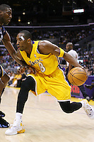 28 December 2005: Guard Kobe Bryant of the Los Angeles Lakers drives to the basket against the Memphis Grizzlies during the Grizzlies 100-99 victory over the Lakers at the STAPLES Center in Los Angeles, CA.