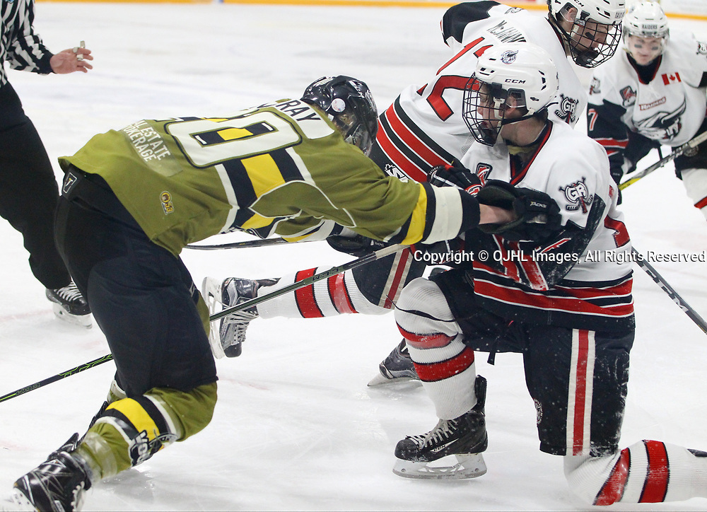 TRENTON, ON  - MAY 4,  2017: Canadian Junior Hockey League, Central Canadian Jr. &quot;A&quot; Championship. The Dudley Hewitt Cup. Game 5 between Powassan Voodoos and the Georgetown Raiders.  Dayton Murray #20 of the Powassan Voodoos checks Jack Hughes #16 of the Georgetown Raiders during the third period.<br /> (Photo by Tim Bates / OJHL Images)