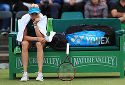 Donna Vekic sits injured in her chair during her semi final match with Johanna Konta during day six of the Nature Valley Open at Nottingham Tennis Centre.