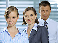 Portrait of businessman and businesswomen smiling in office