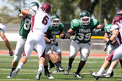 08 September 2012:  Sean Conley makes the hole larger for T.J. Stinde during an NCAA division 3 football game between the Alma Scots and the Illinois Wesleyan Titans which the Titans won 53 - 7 in Tucci Stadium on Wilder Field, Bloomington IL