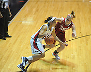 Ole Miss' Diara Moore (10) vs. Arkansas' Melissa Wolfe (33) in a women's college basketball game in Oxford, Miss. on Thursday, January 31, 2013. Arkansas won 77-66.