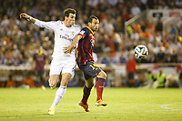 Real Madrid´s Gareth Bale (L) and F.C. Barcelona´s Mascherano during the Spanish Copa del Rey `King´s Cup´ final soccer match between Real Madrid and F.C. Barcelona at Mestalla stadium, in Valencia, Spain. April 16, 2014. (ALTERPHOTOS/Victor Blanco)