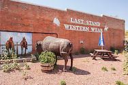 Hardin, Montana, downtown, Western wear store, bison statue.