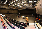 Piano, tables, empty chairs at Meany Studio Theater, University of Washington, Seattle, Washington
