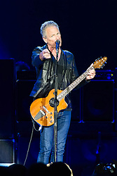 © Licensed to London News Pictures. 24/09/2013. London, UK.   Lindsey Buckingham of Fleetwood Mac performing live at The O2 Arena. Fleetwood Mac are a British-American rock band formed in 1967 in London consisting of Mick Fleetwood (drums), John McVie (bass), Lindsey Buckingham (guitar/vocals) and Stevie Nicks (vocals).  Photo credit : Richard Isaac/LNP