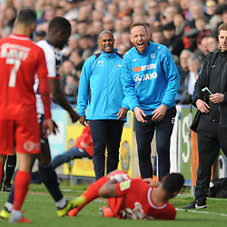 TELFORD COPYRIGHT MIKE SHERIDAN 23/3/2019 - Gavin Cowan laughs after Jamie Turley of Orient goes down theatrically during the FA Trophy Semi Final fixture between AFC Telford United and Leyton Orient at the New Bucks Head