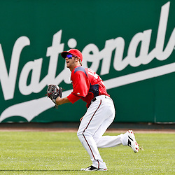 March 4, 2011; Viera, FL, USA; Washington Nationals right fielder Bryce Harper (34) chases down a fly ball during a spring training exhibition game against the Atlanta Braves at Space Coast Stadium.  Mandatory Credit: Derick E. Hingle
