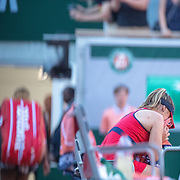PARIS, FRANCE June 01. Sofia Kenin of the United States sobs in her chair after beating Serena Williams of the United States who leaves the court in the background during the Women's Singles third round match on Court Philippe-Chatrier at the 2019 French Open Tennis Tournament at Roland Garros on June 1st 2019 in Paris, France. (Photo by Tim Clayton/Corbis via Getty Images)