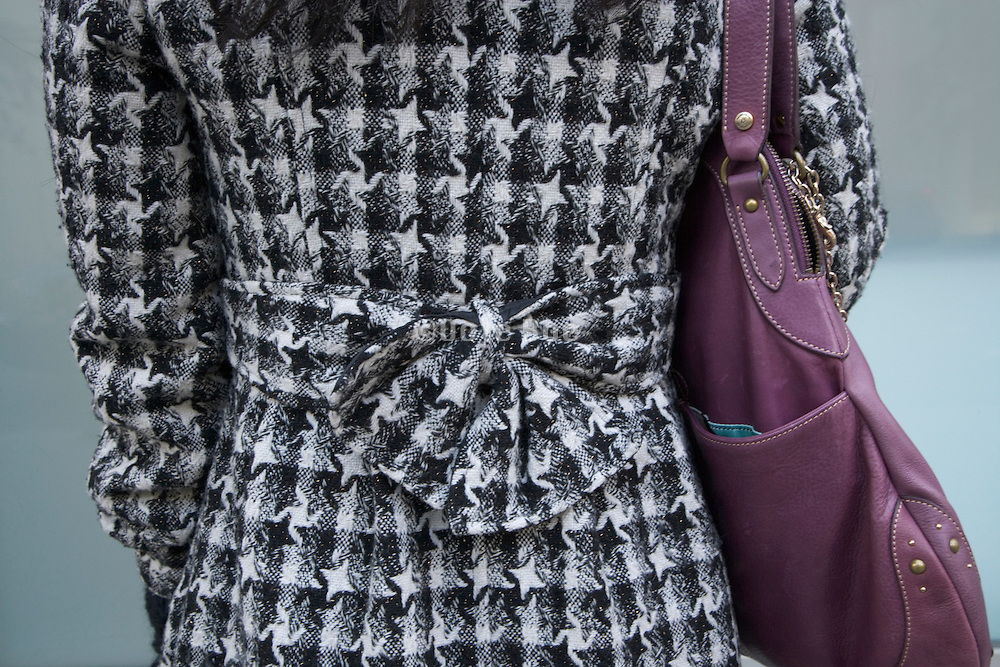 ornamental tie on the back of a coat
