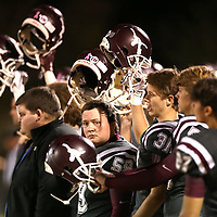 Adam Robison | BUY AT PHOTOS.DJOURNAL.COM<br /> Kossuth players raise their helmets during kickoff against East Side Friday night.