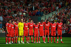 LIVERPOOL, ENGLAND - Sunday, April 11, 2010: Liverpool's players observe a minutes silence to mark the 21st anniversary of the Hillsborough Stadium Disaster of the 15th April 1989, in which 96 Liverpool supporters lost their lives, before the Premiership match against Fulham at Anfield, the nearest game to the anniversary. (Photo by: David Rawcliffe/Propaganda)