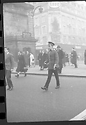 Peter Hughes in Guard Uniform.   B269..1960..06.01.1960..01.06.1960..6th January 1960..Pictured strolling through Dublin was Mr Peter Hughes resplendent in his Guards Uniform...Peter crosses O'Connell Street towars Henry Street. Nelson's Pillar is pictured to his right.
