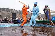 NEDERLAND, CO - MARCH 10: Two men jump into icy brown water in the Frozen Dead Guy Days Polar Plunge competition at the event on March 10, 2018 in Nederland, Colorado. The Frozen Dead Guy Days festival is in honor of Bredo Morstol, who is frozen on dry ice and housed in a shed above the town. (Photo by Rick T. Wilking/Getty Images)