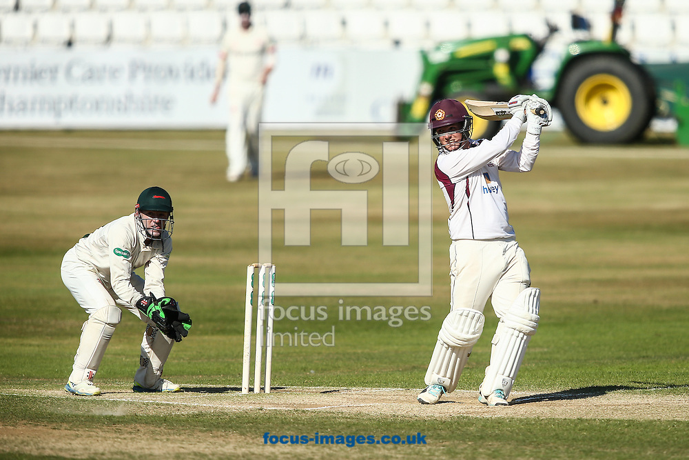 Rob Newton of Northamptonshire CCC (right) hits the ball to the boundary for four during the Specsavers County C'ship Div Two match at the County Ground, Northampton<br /> Picture by Andy Kearns/Focus Images Ltd 0781 864 4264<br /> 15/08/2016