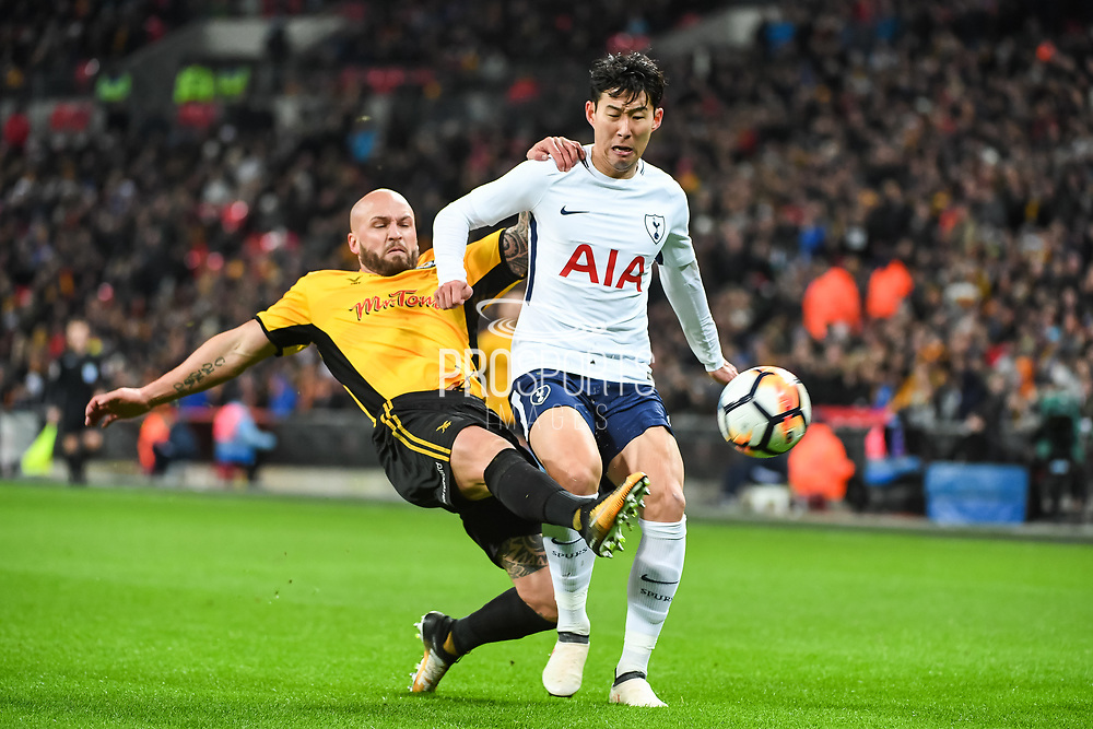 Newport County Defender David Pipe (2) and Tottenham Hotspur Forward Son Heung-Min (7) battle for the ball during the The FA Cup 4th round replay match between Tottenham Hotspur and Newport County at Wembley Stadium, London, England on 7 February 2018. Picture by Stephen Wright.