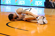 Nov 15, 2013; Phoenix, AZ, USA; Brooklyn Nets guard Deron Williams (8)  holds his ankle while laying on the courting in the first half of the game against the Phoenix Suns at US Airways Center. Mandatory Credit: Jennifer Stewart-USA TODAY Sports