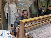 Weaving a talith on a loom Photographed in Jerusalem The Jewish Quarter in the Old City, Israel,