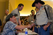 16 MAY 2009 -- PHOENIX, AZ: Rocker and gun owner rights advocate TED NUGENT (LEFT) signs autographs for RODNEY CONNOR at the NRA convention in Phoenix Saturday. About 60,000 people were expected to attend the trade show at the 138th annual National Rifle Association Annual Meeting in the Phoenix Convention Center in Phoenix, AZ. Photo by Jack Kurtz
