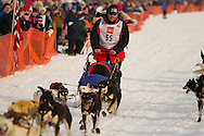 05 March 2006: Willow, Alaska - Ron Cortte passes the team of Paul Ellering during the restart of the 2006 Iditarod on Willow Lake in Willow, Alaska