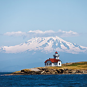 Patos Island Light House at Alden Point with Mount Baker in distance, Patos Island, Washington