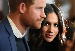 """File photo dated 13/02/18 of the Duke and Duchess of Sussex during a reception for young people at the Palace of Holyroodhouse, in Edinburgh as part of their visit to Scotland. The royal couple have announced they are to """"step back"""" as senior members of the royal family and will now divide their time between the UK and North America."""
