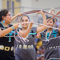 Tse Yi Gai High School students Tianna Toledo, right, Ferissa Ramon and Shenelle Navajo perform a sash dance during the Gallup McKinley County Schools Navajo Language and Culture Day at Miyamura High School Tuesday.