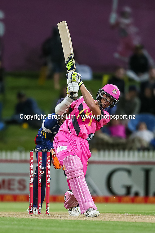 Knights' Mitchell Santner hits a six during the McDonalds Super Smash T20 cricket match - Knights v Aces played at Seddon Park, Hamilton, New Zealand on Saturday 17 December.<br /> <br /> Copyright photo: Bruce Lim / www.photosport.nz