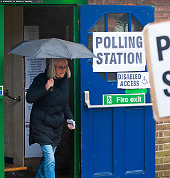 ©Licensed to London News Pictures 12/12/2019. <br /> Bromley,UK. A lady leaving the polling station with an umbrella up. People battle against the wet weather to vote in the UK General Election at Hayes village hall, Hayes, Bromley, South East London. Photo credit: Grant Falvey/LNP
