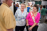 Sandy Hardies chats with Deaconess Katie Ziegler, a missionary in the Dominican Republic, at the 36th Biennial Convention of the Lutheran Women's Missionary League on Friday, June 26, 2015, at the Iowa Events Center in Des Moines, Iowa. LCMS Communications/Erik M. Lunsford