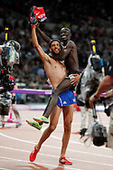 French runner Mahiedine Mekhissi-Benabbad (left) carries Kenya's Ezekiel Kemboi Sunday, Aug. 5, 2012 as the two celebrate after winning silver and gold in the men's 3000 meter steeplechase at the 2012 Olympic Games in London.