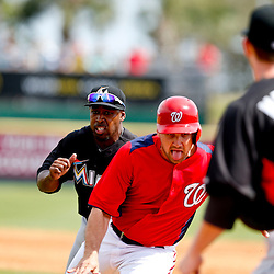 Mar 9, 2013; Melbourne, FL, USA; Miami Marlins second baseman Chone Figgins chases down Washington Nationals designated hitter Ryan Zimmerman for an out during the bottom of the third inning of a spring training game at Space Coast Stadium. Mandatory Credit: Derick E. Hingle-USA TODAY Sports