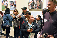 Guests enjoy the December 5th opening of the Stories from Salinas exhibition at the CSUMB Salinas Center for Arts and Culture in Oldtown. The exhibition celebrates the mentors, youth and families of the Salinas Youth Initiative.