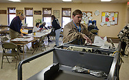 Adam Moraine of Des Moines feeds his ballot into the machine at a voting location in Des Moines, Iowa on Tuesday November 2, 2010. (Stephen Mally for The New York Times)