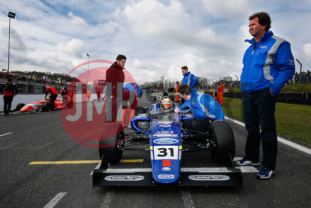Trevor Carlin (R) stands over his driver Lando Norris | #31 Carlin | MSA FormulaChampionship | Race 2 - Photo mandatory by-line: Rogan Thomson/JMP - 07966 386802 - 04/04/2015 - SPORT - MOTORSPORT - Fawkham, England - Brands Hatch Circuit - British Touring Car Championship Meeting Day 2.