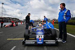 Trevor Carlin (R) stands over his driver Lando Norris | #31 Carlin | MSA FormulaChampionship | Race 2 - Photo mandatory by-line: Rogan Thomson/JMP - 07966 386802 - 04/04/2015 - SPORT - MOTORSPORT - Fawkham, England - Brands Hatch Circuit - British Touring Car Championship Meeting Day 2.
