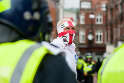 "Rotherham England<br /> 13 September 2014 <br /> an EDL supporter and Police in full Riot kit on the streets close to Rotherham Town Hall before the start of the English Defence Leagues Justice for the Rotherham 1400 March on Saturday Afternoon described by an EDL Facebook Page as ""a protest against the Pakistani Muslim grooming gangs"" on Saturday Afternoon <br /> <br /> <br /> Image © Paul David Drabble <br /> www.pauldaviddrabble.co.uk"
