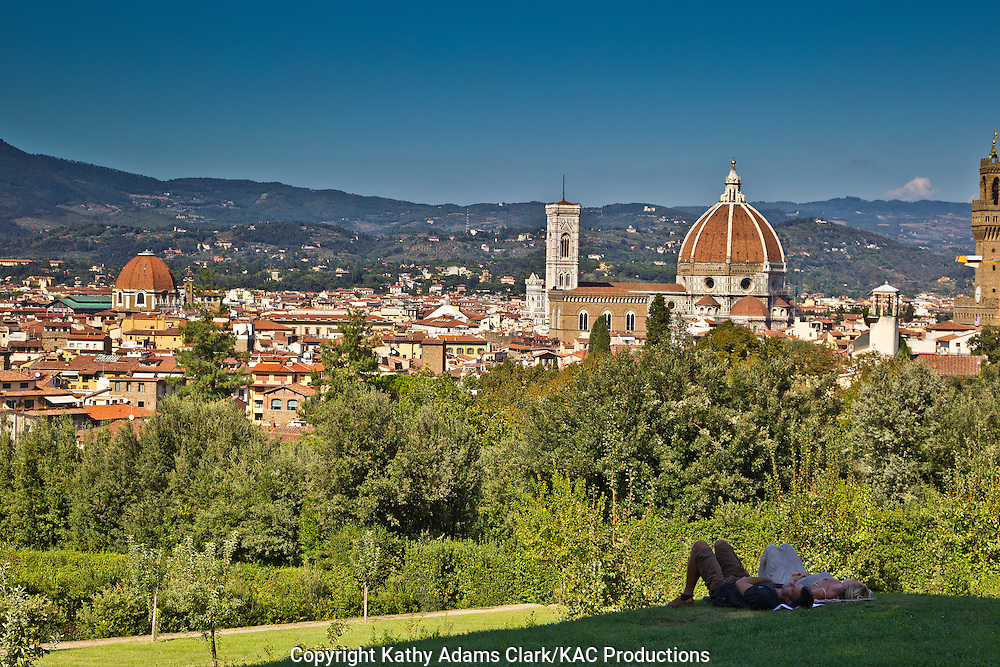 Couple in the park, overlooking the skyline of Florence, Firenze, Italy, from the Pitti Palace, with the Duomo and Santa Maria del Fiore.