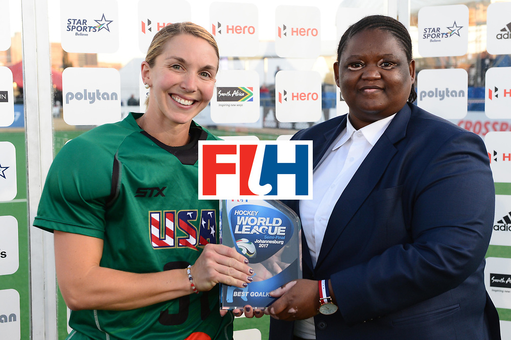 JOHANNESBURG, SOUTH AFRICA - JULY 23: Best Goal Keeper Jackie Briggs of United States of America receives her award for Vice President of the South African Hockey Association, Lwandile Simelane during day 9 of the FIH Hockey World League Women's Semi Finals, final  match between United States and Germany at Wits University on July 23, 2017 in Johannesburg, South Africa. (Photo by Getty Images/Getty Images)