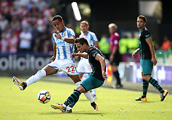 Cedric Soares of Southampton clears under pressure from Tom Ince of Huddersfield Town - Mandatory by-line: Matt McNulty/JMP - 26/08/2017 - FOOTBALL - The John Smith's Stadium - Huddersfield, England - Huddersfield Town v Southampton - Premier League