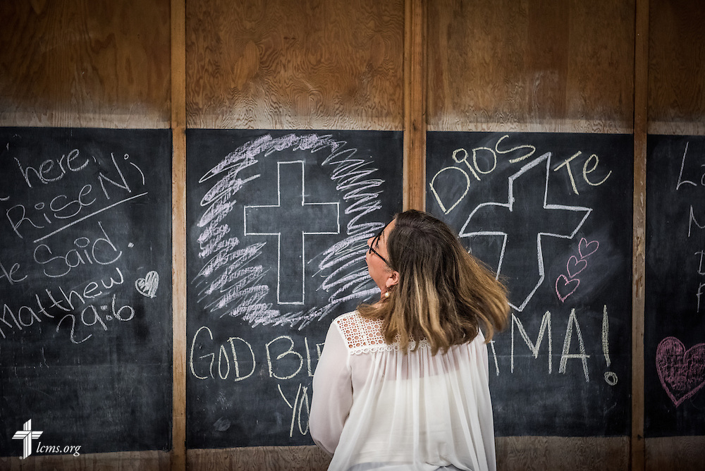 Gloria Palacios moves the blackboards at El Calvario Lutheran Church on Sunday, April 17, 2016,  in Brownsville, Texas. LCMS Communications/Erik M. Lunsford