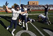 Sabetha's Ryan Stapleton celebrates after the Bluejays defeated Pratt 43-42 in overtime of the 3A state championship game Saturday, Nov. 24, 2018 in Hutchinson, Kan. [Travis Morisse]